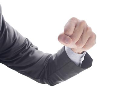 Business mans hand hold fist and punch, isolated on white background, business concept in fight or strength.