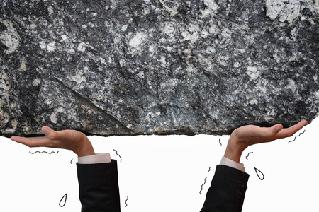 metaphor: Busines man hand carrying and making effort to push up big stone, metaphor to people carry big problem or difficult situation on their own shoulder. Blank copyspace for your text or your design on stone texture.