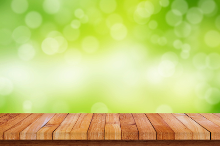 Wood floor with green color of nature and bokeh background. Empty space for your text, design or copyspace.