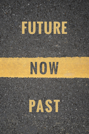 Top view of asphalt road with yellow dividing stripes in the middle with text in concept of we are from Past, and stand on Now and go ahead to Future. Abstract background.