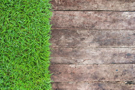 wood grass: Grunge old wood floor panels with green grass background, top view. Empty and blank space for your copyspace, text, or design work. Stock Photo