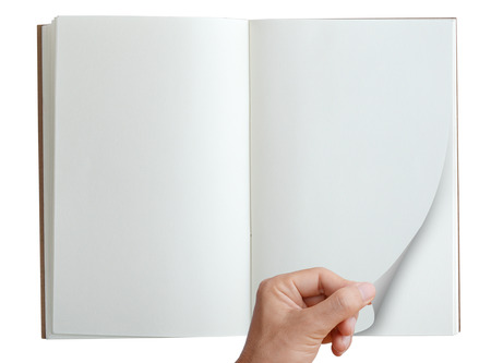 notebook page: Hand pick and open page of notebook isolated on white, top view.
