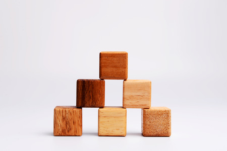 Cube wood block in pyramid form, symbolizing to stable, stability, balancing. Stock Photo