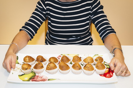 sprinkling: Woman with home made muffins Stock Photo