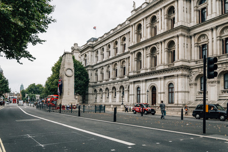 London, UK - August 18, 2015: Whitehall street in London a cloudy day with cetotaph war memorial and Foreign and Commonwealth Office Editorial