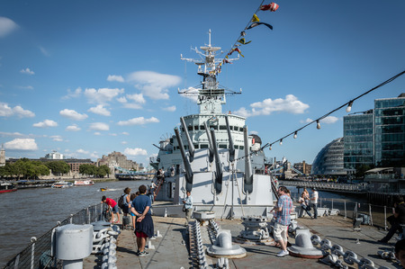 hms: LONDON, UK - AUGUST 22, 2015:   Tourist on the deck of the HMS Belfast in London a sunny day with blue sky Editorial