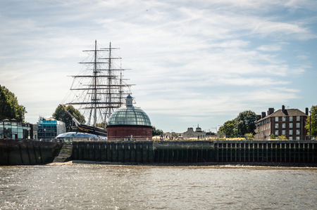 sark: LONDON, UK - AUGUST 22, 2015: Greenwich, London, from the river with the old ship Cutty Sark