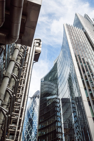 willis: LONDON, UK - AUGUST 21, 2015:  Low angle view of some buildings in the City of London: Lloyds, Willis and Gherkin Tower