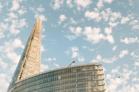 southwark: LONDON, UK - AUGUST 21, 2015:  Low angle view of News building and The Shard designed by the the architect Renzo Piano and located on Southwark, London