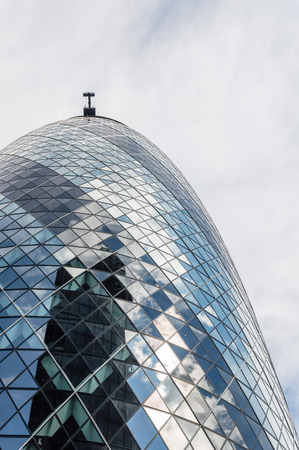 gherkin: LONDON, UK - AUGUST 21, 2015:  Detail of Gherkin Tower designer by the architect Norman Foster. It´s the headquarters of an insurance company