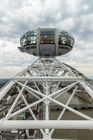 millennium wheel: LONDON, UK - AUGUST 23, 2015: London Eye´s structural detail in a cloudy morning. The London Eye is giant Ferris wheel on the South Bank of the River Thames in London. Also known as the Millennium Wheel.