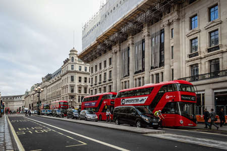 double decker: LONDON, UK - AUGUST 20, 2015: View of Regent Street with typical double decker buses. Regent Street is one of the major shopping streets in Europe. Editorial
