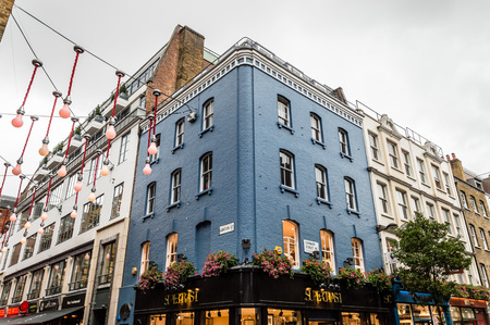city of westminster: LONDON, UK - AUGUST 24, 2015: View of Carnaby Street. Carnaby Street is a pedestrianised shopping street in Soho in the City of Westminster, London Editorial