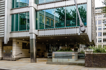 architectural firm: LONDON, UK - AUGUST 21, 2015:  Entrance of Lloyds Banking Group Headquarters building. It´s an office building designed by Grimshaw architectural firm