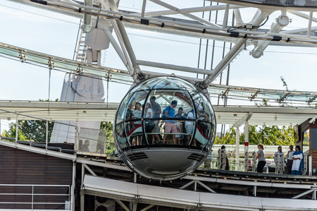 millennium wheel: LONDON, UK - AUGUST 23, 2015: People getting on the glass cabins of London Eye. The London Eye is giant Ferris wheel on the South Bank of the River Thames in London. Also known as the Millennium Wheel.