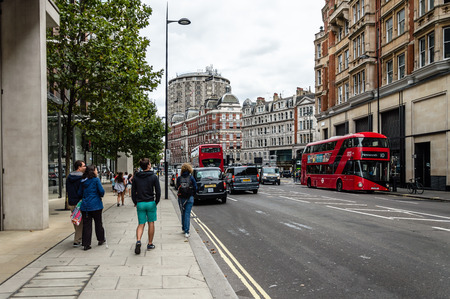 knightsbridge: London, UK - August 19, 2015: Knightsbridge is an exclusive residential and retail district in central London, is home to many expensive shops, fashion houses and luxury apartments Editorial