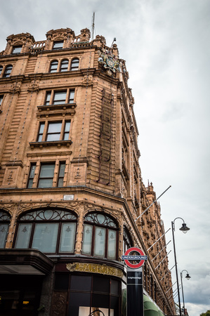 knightsbridge: London, UK - August 19, 2015: Low angle view of Harrods Department Store. Harrods is the most famous and luxury department store in the world. Editorial