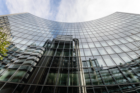 willis: LONDON, UK - AUGUST 21, 2015:  Low angle view of some buildings in the City of London: Lloyds and Willis