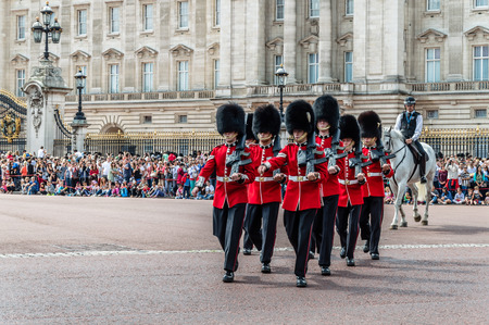 marching: London, UK - August 19, 2015: Royal Guards parade during traditional Changing of the Guards ceremony near Buckingham Palace. This ceremony is one of the most popular tourist attractions in London.
