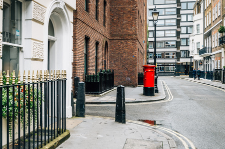 Red mailbox in a street of London