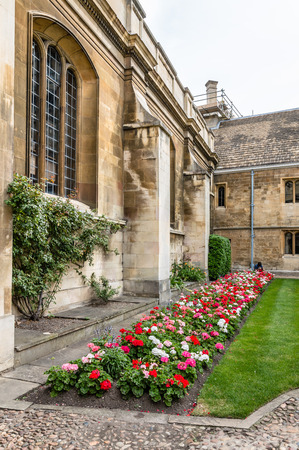 campus tour: CAMBRIDGE, UK - AUGUST 11, 2015:  Courtyard with flowers in the Gonville & Caius College in the University of Cambridge. Cambridge is a university city and one of the top five universities in the world. Editorial