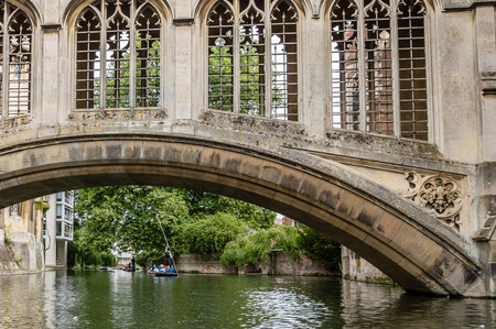 punting: CAMBRIDGE, UK - AUGUST 11, 2015:   Bridge of sighs. Punting on the river Cam. Some companies and students hire punts to visitors and tourists. Cambridge is a university city and one of the top five universities in the world. Editorial