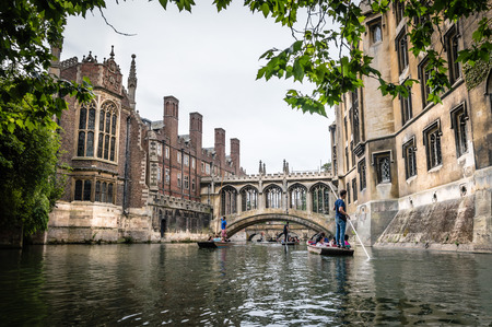 CAMBRIDGE, UK - AUGUST 11, 2015:   Bridge of sighs. Punting on the river Cam. Some companies and students hire punts to visitors and tourists. Cambridge is a university city and one of the top five universities in the world. Editorial