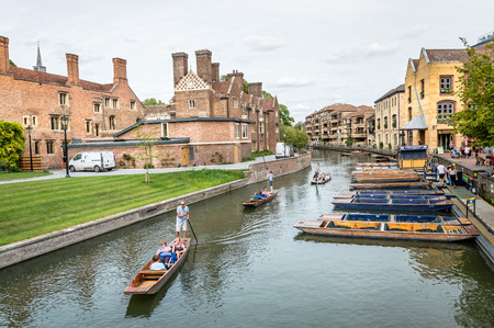 punting: CAMBRIDGE, UK - AUGUST 11, 2015:   Punting on the river Cam. Some companies and students hire punts to visitors and tourists. Cambridge is a university city and one of the top five universities in the world. Editorial