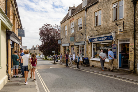 STOW-ON-THE-WOLD, UK - AUGUST 12, 2015:  Commercial street with tourists in Stow on the Wold. Stow on the Wold is a historical market town in the Cotswolds