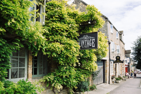 stow: STOW-ON-THE-WOLD, UK - AUGUST 12, 2015:  Typical antique shop entrance decorated with flowers and natural elements. Stow on the Wold is a historical market town in the Cotswolds Editorial