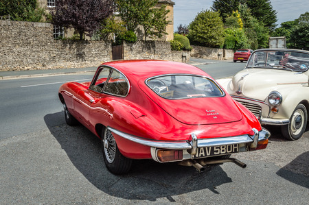 stow: STOW-ON-THE-WOLD, UK - AUGUST 12, 2015:  Street in Stow on the Wold with old luxury sport cars. Stow on the Wold is a historical market town in the Cotswolds