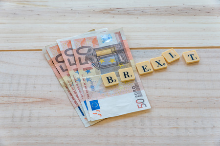 yes or no to euro: Brexit text with euro money on wooden background. The United Kingdom European Union membership referendum on 23 June 2016 Stock Photo