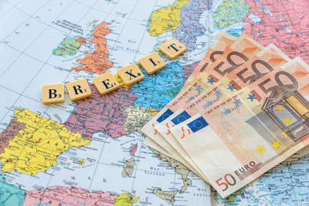Brexit word with euro money on european map. The United Kingdom European Union membership referendum on 23 June 2016