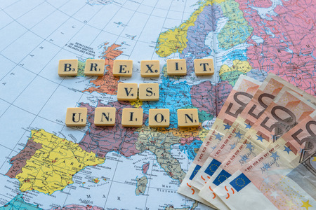 yes or no to euro: Brexit vs Union words on european map with euro money. The United Kingdom European Union membership referendum on 23 June 2016