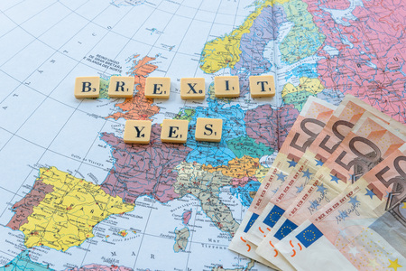 yes or no to euro: Brexit Yes words on european map with euro money. The United Kingdom European Union membership referendum on 23 June 2016