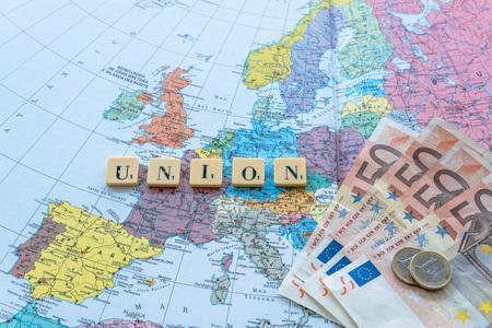 yes or no to euro: Union word with euro money on european map.  The United Kingdom European Union membership referendum on 23 June 2016