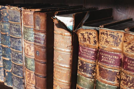 hardcover: Old books with leather hardcover on the shelf Stock Photo