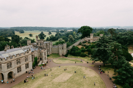 conqueror: High angle view of Warwick Castle. It is a medieval castle built in 11th century by William the Conqueror and a major touristic attraction in UK. Editorial