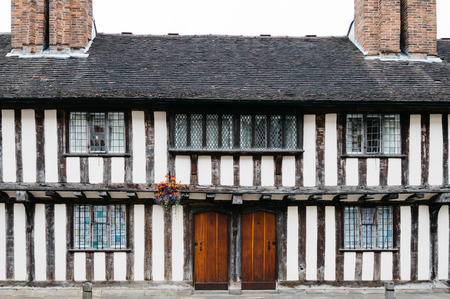 tudor: Front view of typical Tudor houset, a cloudy day Stock Photo