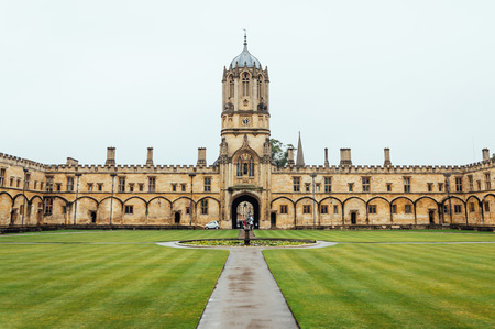 Oxford, UK - August 12, 2015: View of the main courtyard of Christ Church College in Oxford a rainy day The city is known as the home of the University of Oxford, the oldest university in the English speaking world.