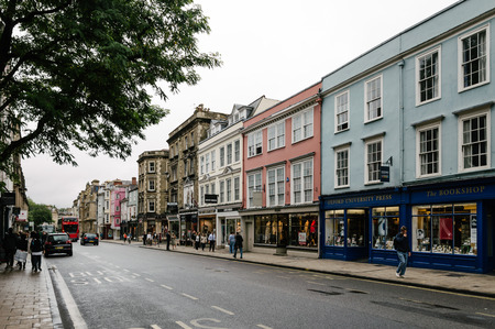 city centre: Oxford, UK - August 12, 2015: High Street in Oxford a rainy day.  This street is the center of the city and is well known for Major buildings and commerce. The city is known as the home of the University of Oxford.