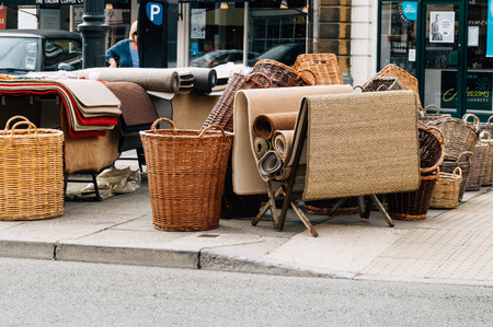 the place is important: Cirencester, UK - August 17, 2015: Wicker baskets and rugs in the Market Place of Cirencester. The city is a market town in the cotswolds and is known to be an important early Roman area.