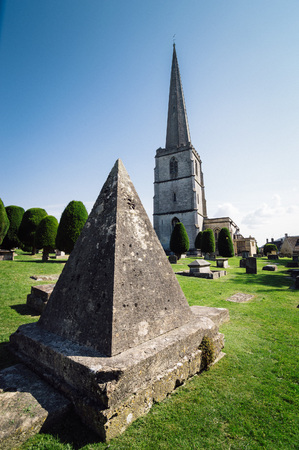 pyramidal: Painswick, UK - August 17, 2015: Pyramidal tomb in the churchyard of St Marys Church. Painswick is a town in the Cotswolds, originally the town grew on the wool trade.