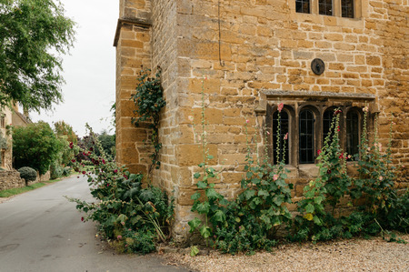 delightful: Stanton, UK - August 17, 2015: Delightful corner of a typical limestone house in the center of the village. It is one of the prettiest and idyllic villages in the  Cotswolds.