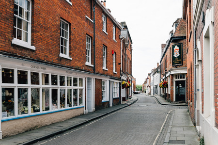 winchester: Winchester, UK - August 16, 2015: Street in the center of the city a cloudy day. It is the ancient capital of England and former seat of King Alfred the Great.