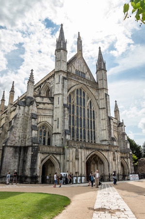 winchester: Winchester, UK - August 16, 2015: Outdoors view of Winchester Cathedral. It is one of the largest cathedrals in Europe, with the longest nave.