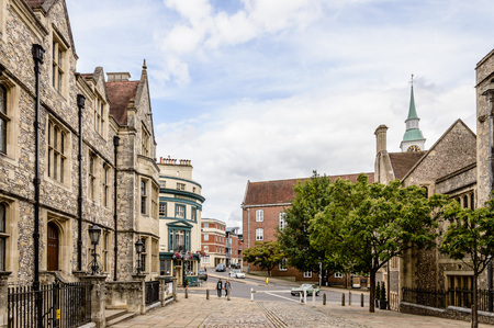 Winchester, UK - August 16, 2015: Street near Great Hall a cloudy day. Winchester is the ancient capital of England and former seat of King Alfred the Great. Editorial