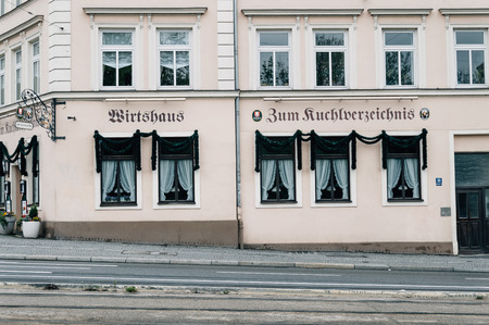 biergarten: Munich, Germany - May 05, 2015: Facade of a typical restaurant in Munich. Beer and local food are served, typically at shared tables.