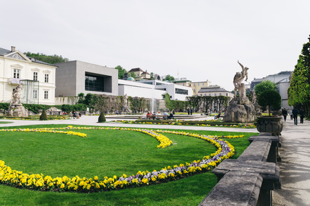 mozart: Salzburg, Austria - April 29, 2015:   Mirabell Gardens. Salzburg is renowned for its baroque architecture and was the birthplace of Mozart. It is an Unesco World Heritage Site. Editorial