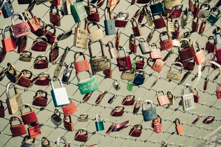 renowned: Salzburg, Austria - April 29, 2015:   Padlocks in a bridge over river. Salzburg is renowned for its baroque architecture and was the birthplace of Mozart. It is an Unesco World Heritage Site. Editorial